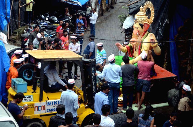 """Kolhapurcha Raja"""" Ganesh idol being taken to its designated pandal from a Mumbai workshop on July 31, 2016."""