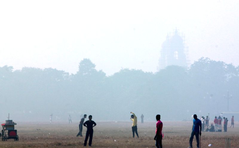 A blanket of fog covers the Maidan in Kolkata on Dec. 27, 2014.