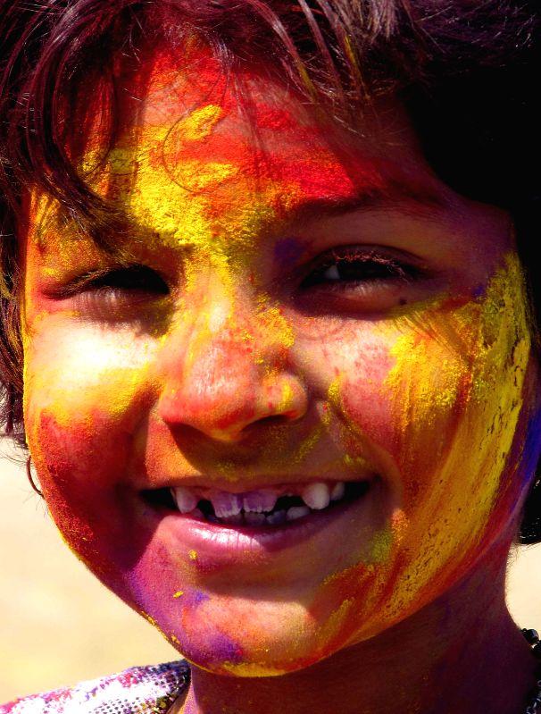 A child celebrates Holi in Kolkata, on March 5, 2015.