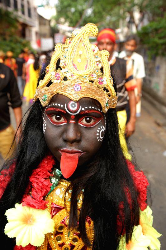 Kolkata A child disguised as goddess Kali during Shiva Gajan Festival in Kolkata, on April 13, 2015.