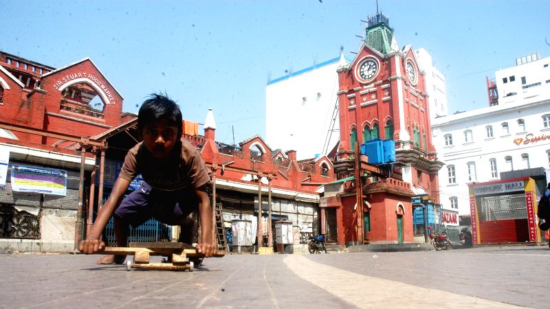 A child plays at New Market - SS Hogg Market - in Kolkata, on March 12, 2015. The shops remained closed for the second consecutive day as shopkeepers continued their strike.