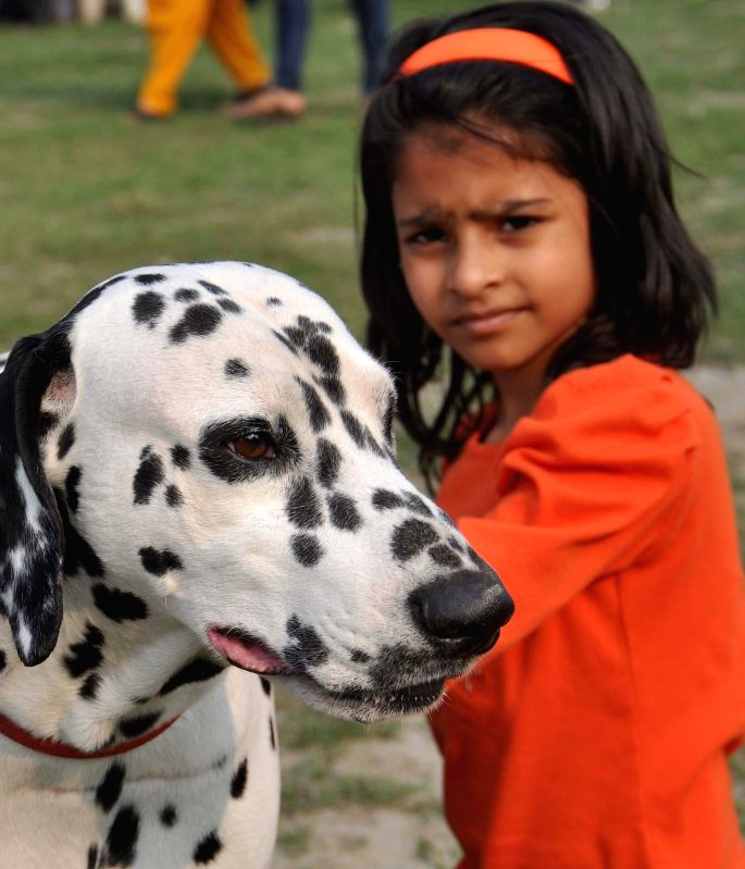 A child with her pet  at a dog show organised at Salt Lake central park in Kolkata, on Jan 25, 2015.