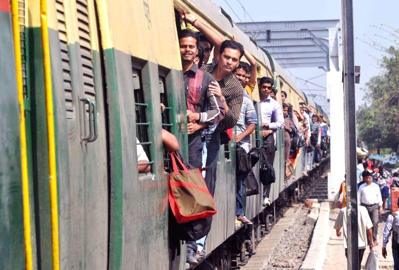 A crowded local train chugs into Bidhannagar Station - a Kolkata Suburban Railway Junction Station in Kolkata, on Feb 26, 2015. Union Railways Minister Suresh Prabhakar Prabhu Thursday ... - Suresh Prabhakar Prabhu Thursday