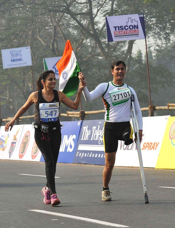 A handicapped man participates in 25K Kolkata Marathon on Dec 28, 2014.