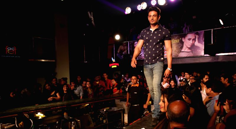 A model walks the ramp at the launch of `FFACE Calendar 2015` in Kolkata, on March 12, 2015.