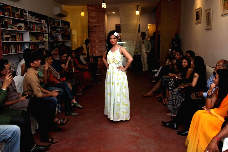 A model walks the ramp during a fashion show in Kolkata, on March 8, 2015.