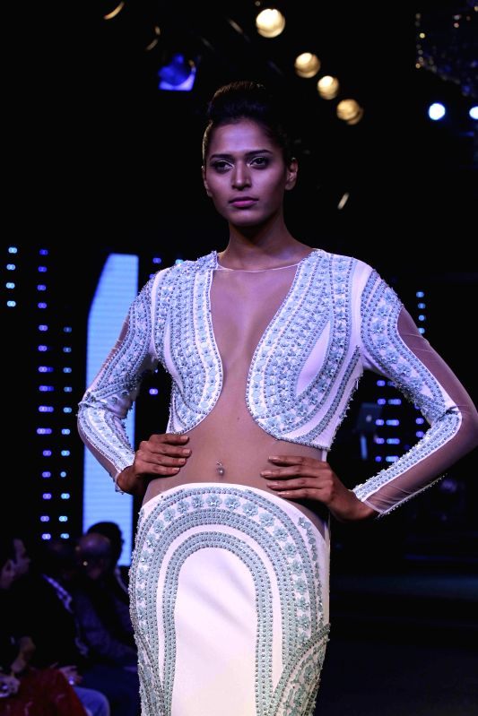 A model walks the ramp during the Blenders Pride Fashion Tour 2014 in Kolkata, on Dec 13, 2014.