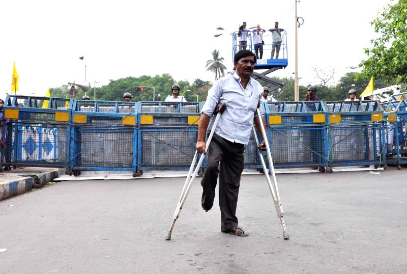 A physically handicapped man participates in a law violation programme against West Bengal Government in Kolkata, on April 6, 2015.