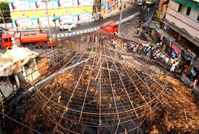 Kolkata: A view of the destroyed marquee of Santoshpur Trikon Park Durgotsab Puja Committee where a fire broke out when it was being dismantled in Kolkata, on Oct 26, 2018.