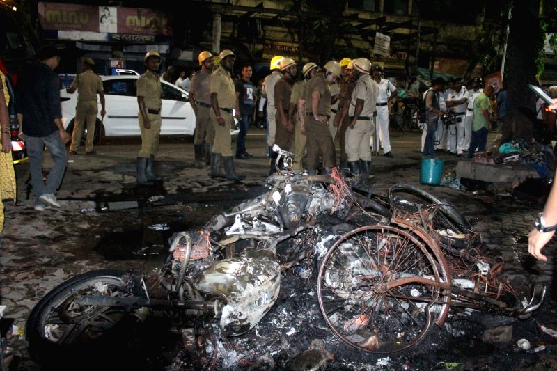 Kolkata: A view of three motorbikes which were set ablaze in the College Street area after Trinamool Congress Chhatra Parishad activists allegedly pelted stones at BJP President Amit Shah's roadshow triggering clashes, in Kolkata, on May 14, 2019. (P