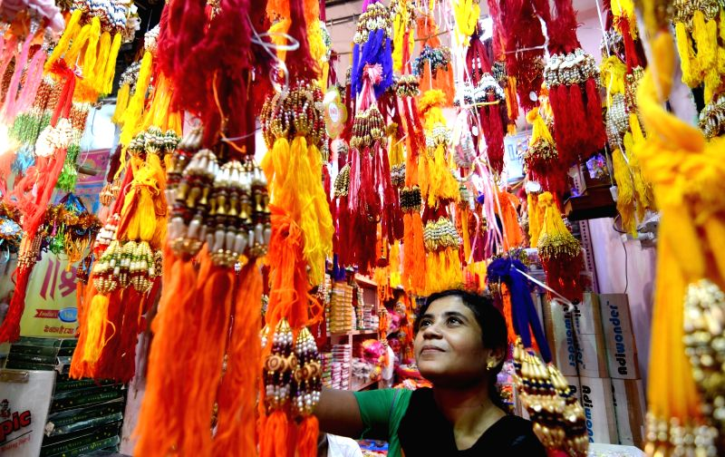Kolkata: A woman busy buying rakhis ahead of Raksha Bandhan in Kolkata on Aug 4, 2019. (Photo: Kuntal Chakrabarty/IANS)