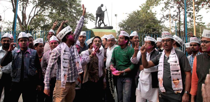 Aam Aadmi Party (AAP) supporters celebrate party's victory in the recently concluded Delhi Assembly Polls in Kolkata, on Feb 10, 2015.