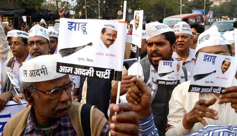 Aam Aadmi Party (AAP) workers participate in a rally organised to celebrate party's victory in the recently concluded Delhi Assembly Polls in Kolkata, on Feb 14, 2015.