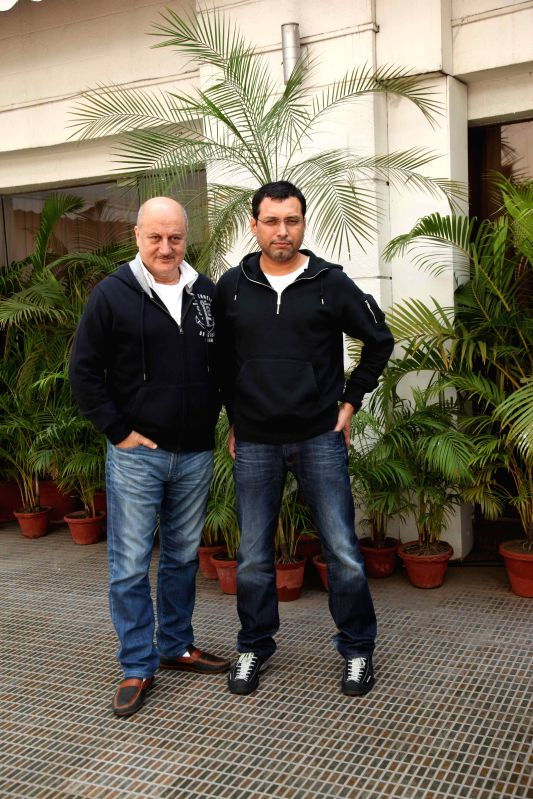 Actor Anupam Kher and director Neeraj Pandey during a press conference to promote their movie Baby in Kolkata on Jan. 24, 2015. - Anupam Kher and Neeraj Pandey