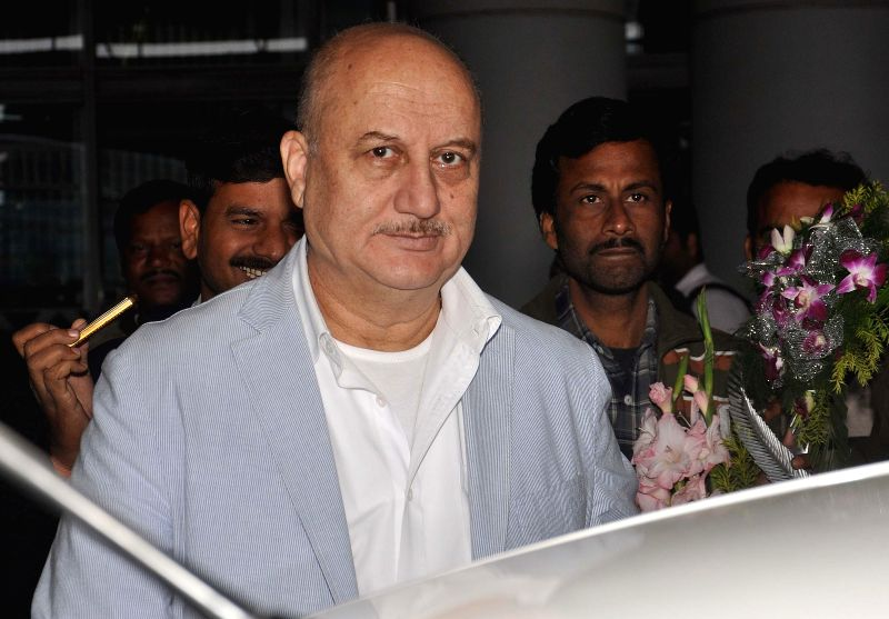 Actor Anupam Kher arrives at Kolkata airport on Jan 24, 2015.
