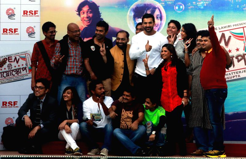 Actor John Abraham with star cast of `Open tee Bioscope` during the music launch of Open Tee Bioscope Film in Kolkata, on Dec 11, 2014.