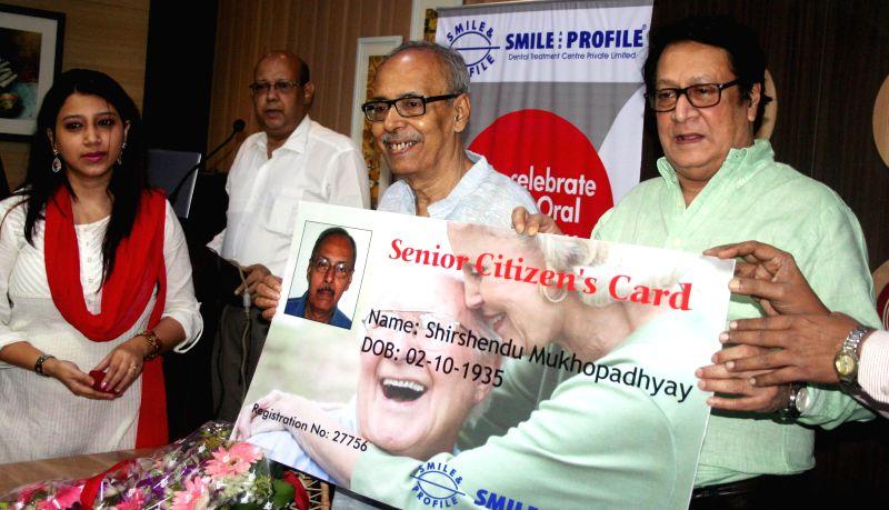Actor Ranjit Mallick and Bengali author Shirshendu Mukhopadhyay at the launch of `Senior Citizen's Card` on World Oral Health Day in Kolkata, on March 20, 2015. - Ranjit Mallick