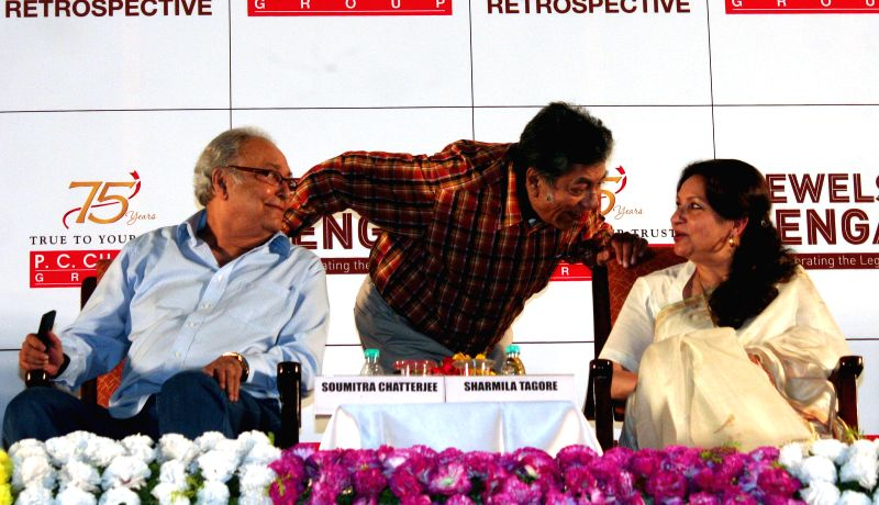 Actors Sharmila Tagore and  Soumitra Chatterjee with filmmaker Sandip Ray during a programme organised to pay tribute to Satyajit Ray in Kolkata, on April 26, 2015.