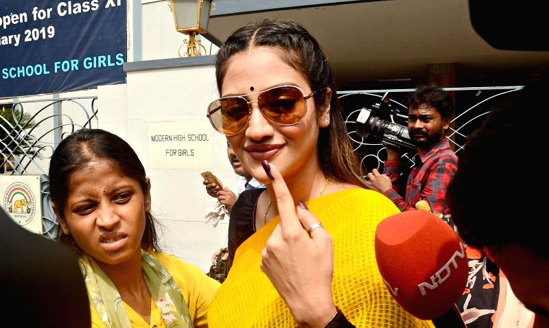 Kolkata: Actress Nusrat Jahan shows her forefinger marked with indelible ink after casting vote during the last phase of 2019 Lok Sabha polls, in Kolkata, on May 19, 2019.
