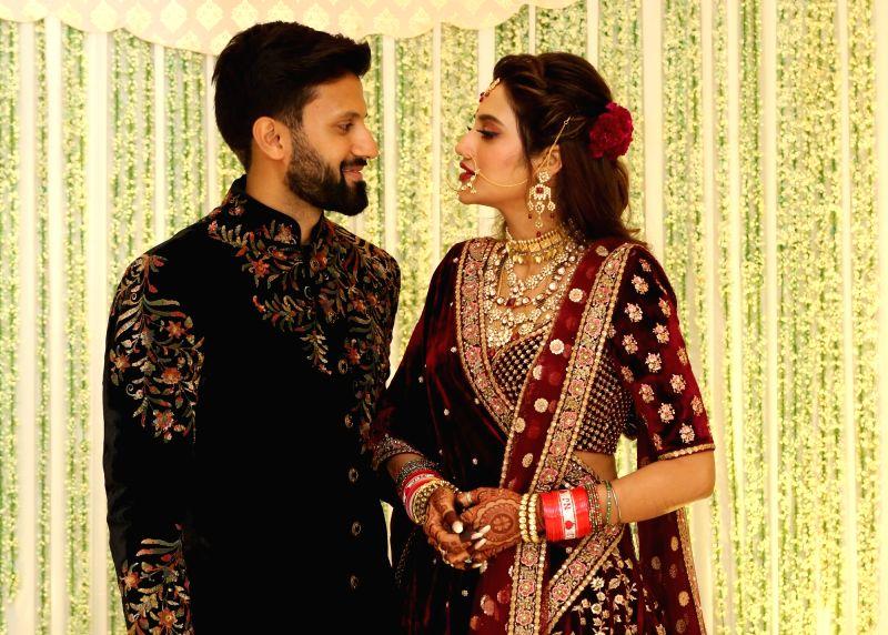 Kolkata: Actress Nusrat Jahan with her husband Nikhil Jain during their wedding reception in Kolkata on July 4, 2019.