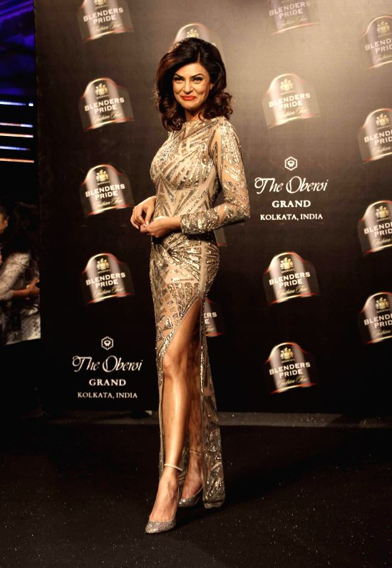 Actress Sushmita Sen showcases fashion designer Namrata Joshipura's creations during the Blenders Pride Fashion Tour 2014 in Kolkata, on Dec 13, 2014.