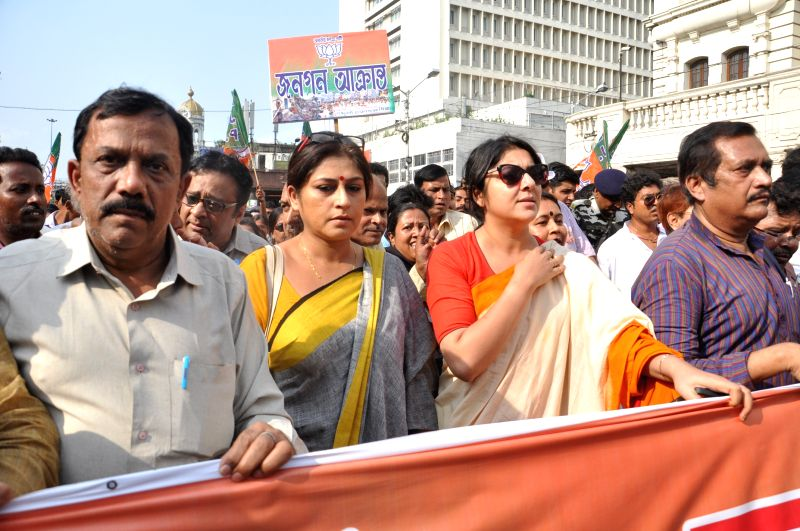 Actress turned BJP politicians Roopa Ganguly, Locket Chatterjee and others take out a protest rally against West Bengal Government in Kolkata on April 27, 2015. - Chatterjee