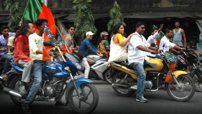 Actress-turned politician Rupa Ganguly campaigns for BJP ahead of KMC polls in Kolkata, on April 15, 2015.