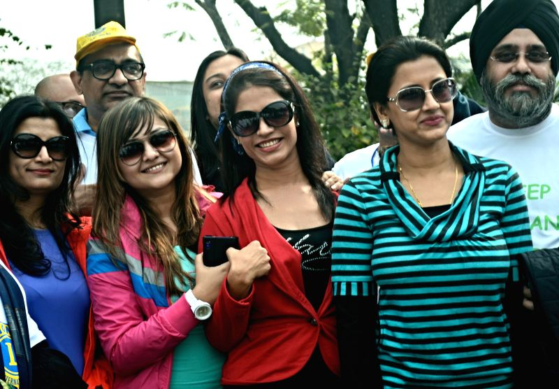 Actresses Koneenica Banerjee, Richa Sharma and Rachana Banerjee participate in Clean City Dream City - a walk from Minto park to Deshapriya Park in Kolkata, on Dec 14, 2014. - Koneenica Banerjee, Richa Sharma and Rachana Banerjee