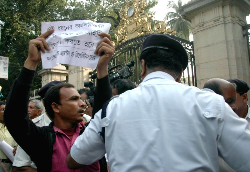 Agents of various chit fund companies demonstrating against West Bengal government in front of Raj Bhawan in Kolkata on Nov 20, 2014.