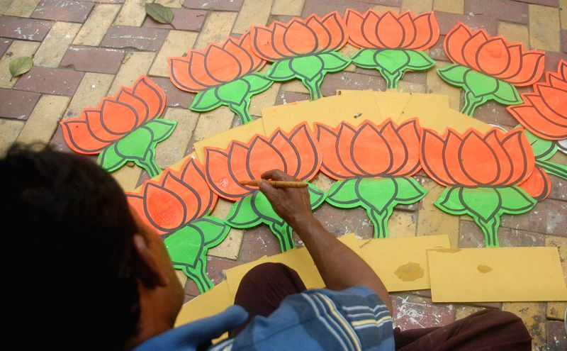An artist busy making political symbols ahead of KMC polls in Kolkata on April 12, 2015.