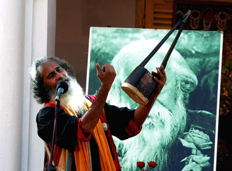 An artist performs during `Folk Music Festival 2015` at Jorasanko Thakur Bari in Kolkata, on Jan 8, 2015.