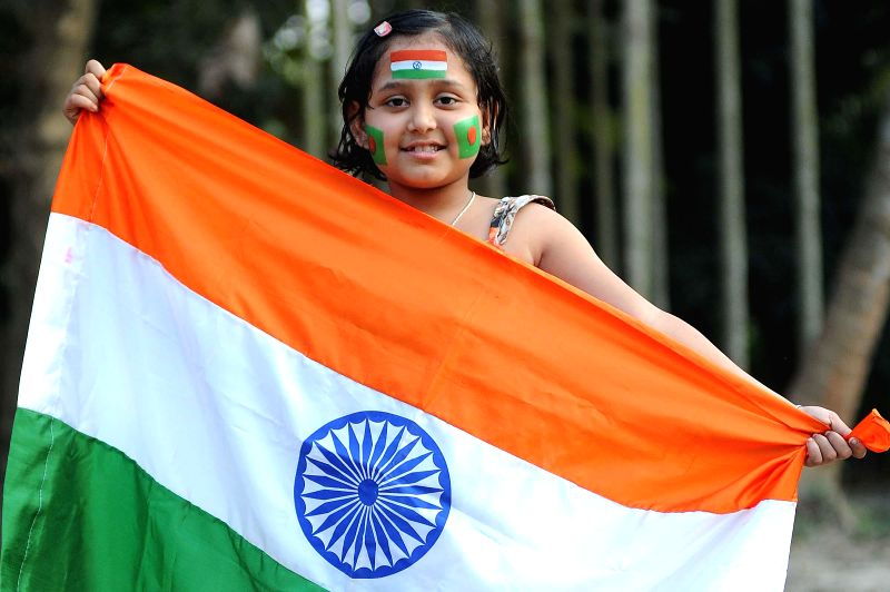 An Indian cricket fan with tricolour painted on her face ahead of the ICC World Cup-2015 quarter final match between India and Bangladesh in Kolkata on March 18.