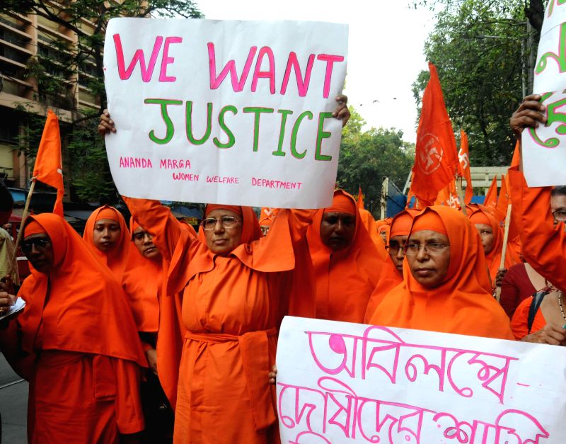 Ananda Margais stage a protest rally to condemn the recent gang rape of a nun in Ranaghat of West Bengal`s Nadia district in Kolkata on March 17, 2015.