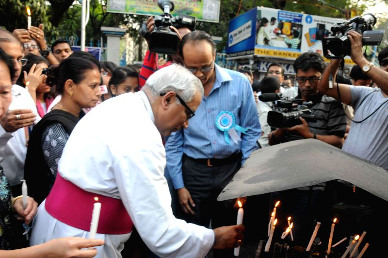 Archbishop Thomas D'Souza prays for the nun who was gang raped in Ranaghat of West Bengal, outside the Allen Park in Kolkata  on March 16, 2015.