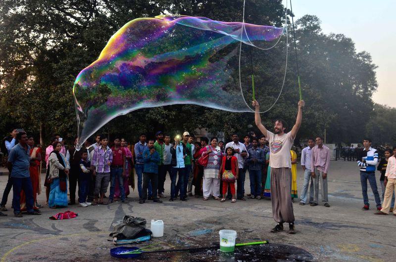 Argentine bubble artist Demian Zen performs with bubbles in front of Victoria Memorial in Kolkata, on Feb 3, 2015. - Demian Zen