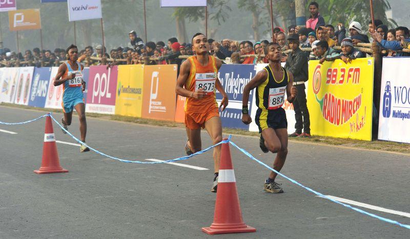 Athletes participate in 25K Kolkata Marathon on Dec 28, 2014.