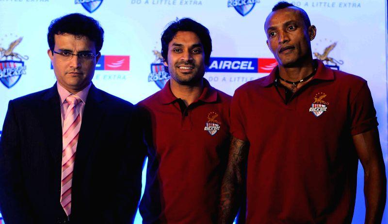 Atletico de Kolkata co-owner Sourav Ganguly, players Subhasish Roy Chowdhury, Fikru Tefera Lemmesa during a press conference at a press meet in Kolkata, on Nov 25, 2014. - Sourav Ganguly and Subhasish Roy Chowdhury