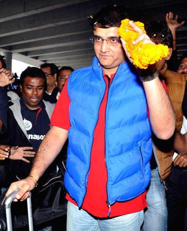 Atletico de Kolkata co-owner Sourav Ganguly arrives at Netaji Subhas Chandra Bose International Airport, after his team won ISL trophy  in Kolkata, on Dec 21, 2014.