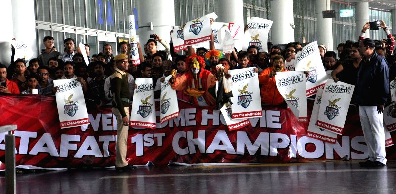 Atletico de Kolkata fans celebrate as the team arrives at Netaji Subhas Chandra Bose International Airport with the ISL trophy in Kolkata, on Dec 21, 2014.