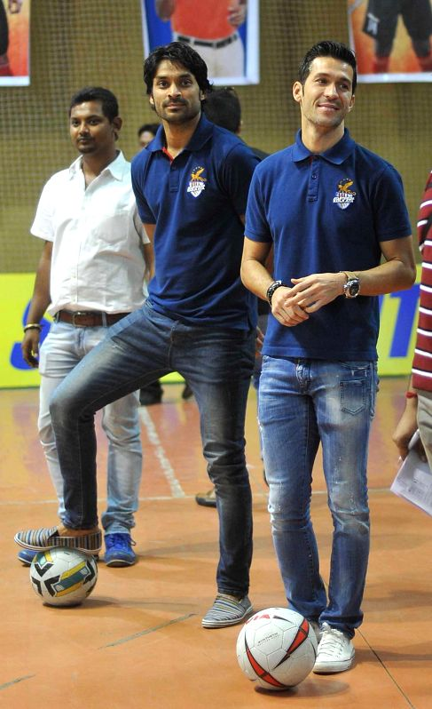 Atletico de Kolkata players Luis Garcia and Subhasish Roy Chowdhury during a promotional event in Kolkata on Dec 11, 2014. - Subhasish Roy Chowdhury