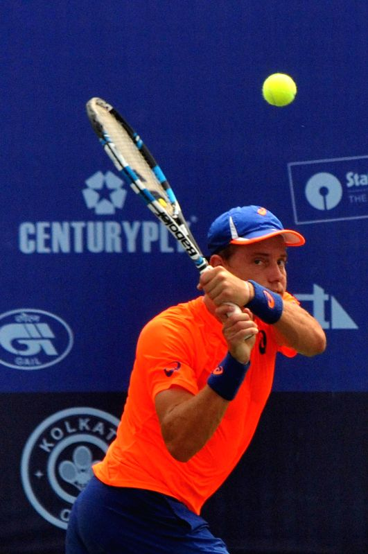 Australian tennis player James Duckworth in action against Indian tennis player Sanam Singh during an Emami Kolkata Open 2015- ATP Challenger match in Kolkata on Feb 25, 2015.