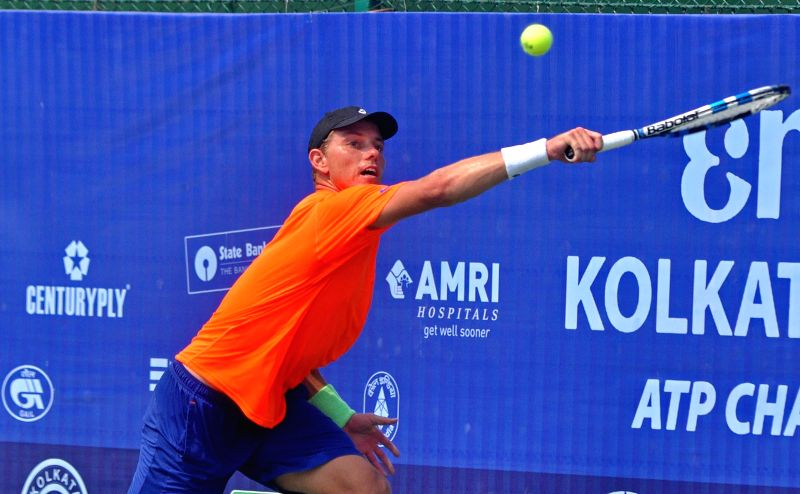 Australian tennis player James Duckworth in action against Belgian player Ruben Bemelmans during an Emami Kolkata Open 2015- ATP Challenger semi-final match in Kolkata on Feb 27, 2015.