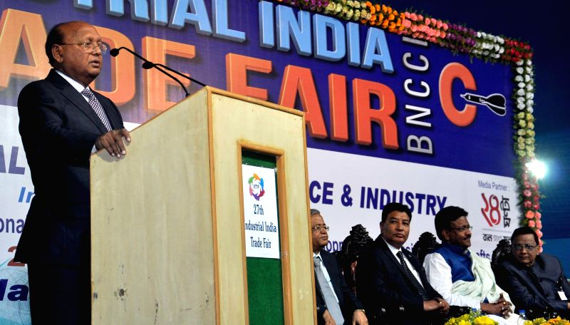 Bangladesh Minister of Commerce Toufail Ahmed addresses during the inauguration of the 27th Industrial India Trade Fair in Kolkata, on Dec 26, 2014. Also seen West Bengal Urban Development .. - Firhad Hakim