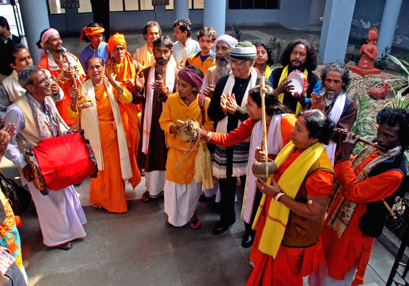 Bauls preform during a Baul Festival and workshop in Kolkata, on Jan 6, 2015. Also seen West Bengal Minister for Backward Classes Welfare Upen Biswas.