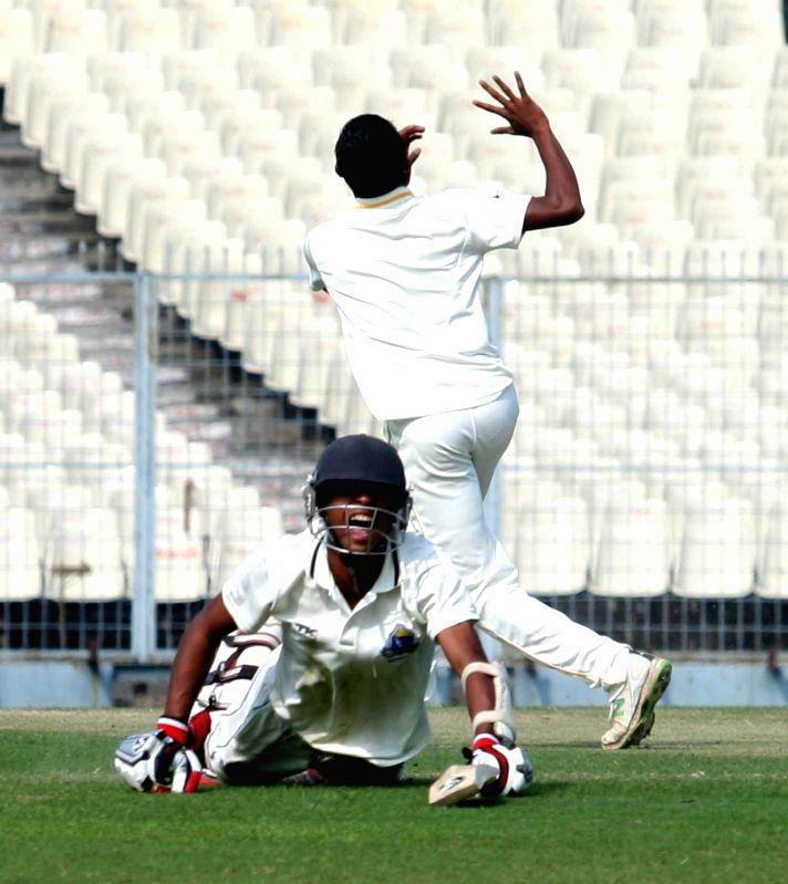 Bengal batsman Abhimanyu Ishwar celebrates his century against Tamil Nadu during a Ranji Trophy match in Kolkata, on Jan 7, 2015.
