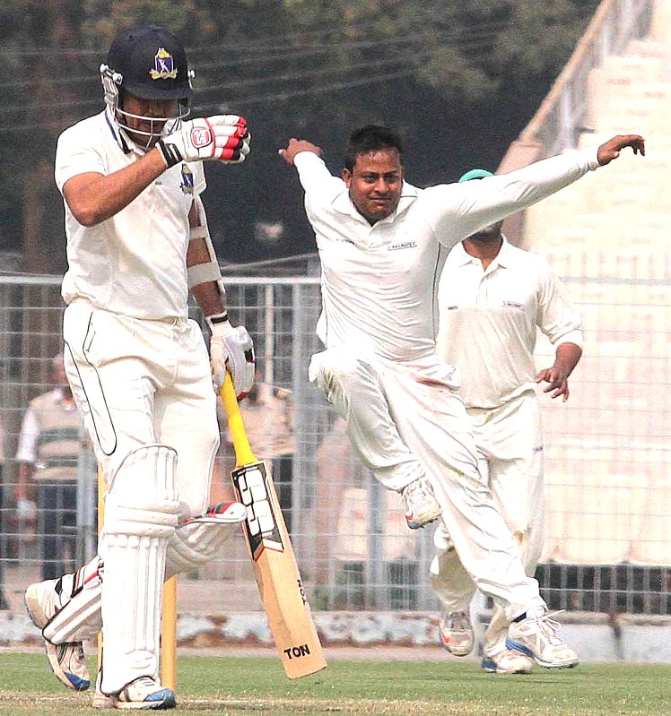 Bengal batsman Laxmi Ratan Sukla going back to the pavilion after getting out against Railways during Ranji Trophy match at Eden Gardens in Kolkata on Jan 29, 2015. - Laxmi Ratan Sukla