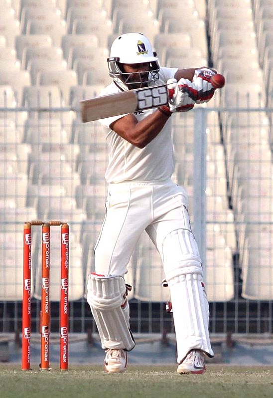 Bengal batsman Manoj Tiwary in action during a Ranji trophy match against Mumbai at Eden Garden in Kolkata on Dec 29, 2014. - Manoj Tiwary