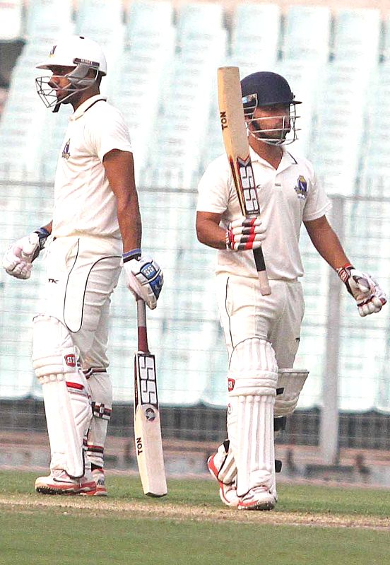 Bengal batsman Shreevats Goswami celebrates after scoring 50 against Railways during Ranji Trophy match at Eden Gardens in Kolkata on Jan 29, 2015. - Shreevats Goswami