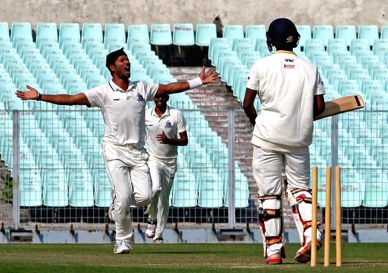 Bengal player Ashok Dinda celebrates fall of a wicket during a Ranji Trophy match against Tamil Nadu at Eden Garden in Kolkata on Jan. 5, 2014.