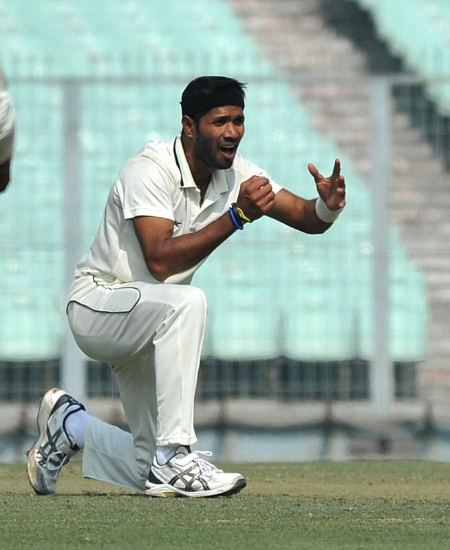 Bengal player Ashok Dinda in action during a Ranji trophy match against Mumbai at Eden Garden in Kolkata on Dec 28, 2014.